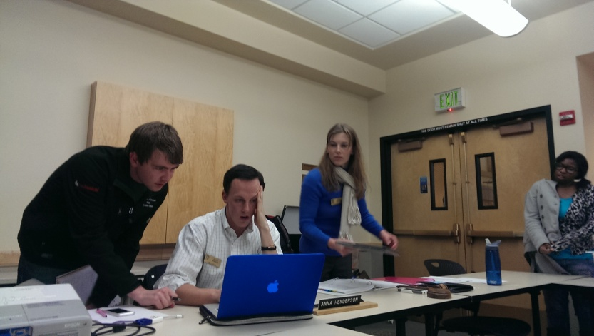 Dylan Roberts (sitting), acting president of CUSG Legislative Council, re-counts votes after student government's weekly meeting adjourned Thursday night, January 23, 2014. (Alison Noon/CU Independent)