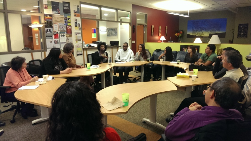 Quengail Ameyaw tells a group of about 19 people gathered in the Center for Community's Center for Multicultural Affairs office details of her what she has perceived to be a racially adverse campus climate. (Alison Noon/CU Independent)