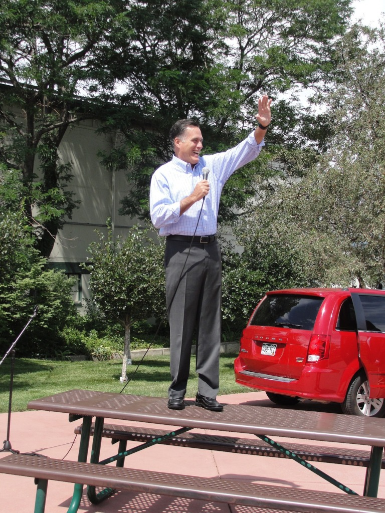 Mitt Romney stands on a table at the Jefferson County Fairgrounds before heading inside to speak to supporters on August 2, 2012.