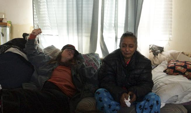 Two days after she says she witnessed her friend attempt to clean up a double-homicide that Weld County deputies and Thornton police are investigating, Rosann O'Donnell, right, took comfort on the couch of another friend, Candy Myers, at about 1 p.m. Saturday at the Friendly Village of the Rockies trailer park. Alison Noon, The Denver Post