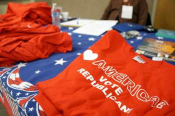Weld County Republicans Treasurer Marge Klein helps sell T-shirts at the party's biannual meeting at the Southwest Weld County Branch Office near Firestone on Saturday. Organizational leaders were elected at the meeting and included Klein's reelection. Alison Noon, The Greeley Tribune