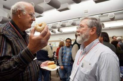 Robert Cassidy, left, and David Feely chat over doughnuts at the Weld County Republicans meeting on Saturday. Alison Noon, The Greeley Tribune