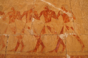 A depiction of the Egyptian army taking offerings to Hatshepsut; the coloring is original dye